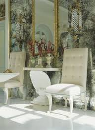 the mirror tile is a fantastic backdrop to this vignette find this pin and more on dining chairs