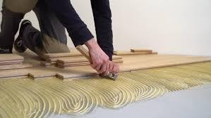 stock of carpenter worker installing wood parquet construction 21856252 shutterstock