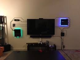 If you can't hide the wires, make them part of the decor.