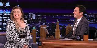 Kelly Clarkson dances along when she ...