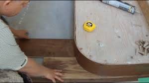 installing hardwood flooring on concrete around curved stair case