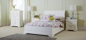 furniture white wooden bed and twin white table lamps on white wooden side table added