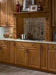 solid brass cabinet hardware finished in black is a beautiful enhancement throughout this kitchen