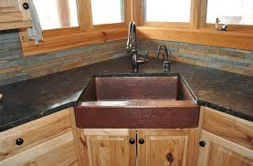 image of hammered copper farmhouse sink for kitchen