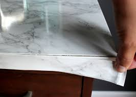 furniture contact paper. apply contact paper to front edge of furniture k