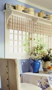 Above-window shelves. i want to do this for my teapots.