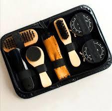 1x sponge shoe brush 1x shoe brush 1 x long shoe brush 1x neutral shoe polish 1x black shoe polish 1x cleaning cloth 1x shoe horn 1 x pu bag