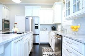 White cabinets with marble countertops Cream Carrera Marble Countertops Marble Marble Cleaning Digicorp Carrera Marble Countertops White Fantasy Kitchen Island Looks Like