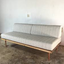 this diy mid century modern sofa is from modern builds you could easily recover old sofa cushions that are in good structural shape for this project