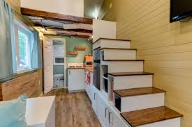 tiny house interior with storage under the staircase  tiny house