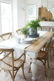 new chairs and greenery in the dining room