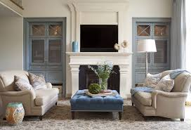built in cabinets next to fireplace living room transitional with limestone fireplace metal grids transitional design