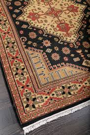 persian tribal black hand knotted wool rug 36258