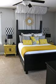 yellow and gray bedroom: element i like this room excellent space shapes and colours excellent sizes and textures and beautiful lines the sun on the grey fabric creates a point