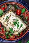 baked feta cheese with onions  red pepper   tomatoes
