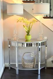 foyer decor using pier 1 elegant glass candlestick lamps mirrored console table and rattan basket