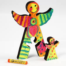 wooden angels painted with oil pastels craft paint and lacquer