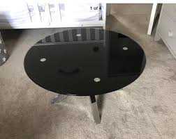 modern round black glass coffee table with metal silver chrome legs