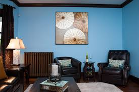 incredible blue living room wall paint ideas combine with brown wood furniture also decorative lamp at corner and wall decoration