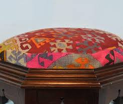 standing on eight legs flanking carved oriental openings this ottoman features a richly moulded frame surrounding