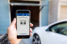 open garage door with iphoneReview Why a Smart Home Starts in the Garage  WSJ