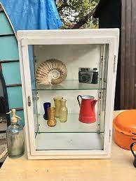 a vintage glass metal wall medical