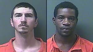 Traffic enforcement results in two arrests, two firearms seized