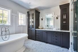black bathroom linen cabinet with metal lattice cabinet doors