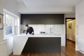 Modern kitchen backsplash glass tile Black Painted Glass The Modern Kitchen Features Caesarstone Dwell Best Modern Kitchen Glass Tile Backsplashes Design Photos And Ideas