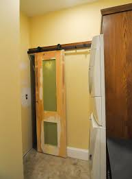 original door expanded and installed barn door style over the laundry closet
