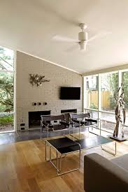 mid century fireplace screen living room midcentury with modern furniture gray painted brick white ceiling fan