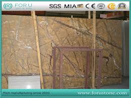 india rainforest brown marble slabs fabricating into tiles