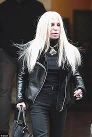 showing no fear donatella walks the streets of milan with her face looking almost alien