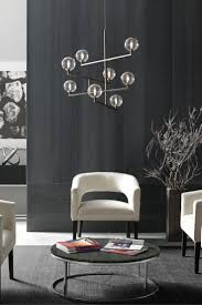 high tech lighting. the gambit led chandelier from tech lighting exudes undeniable beauty and warm contemporary style through its bold use of high end mixed materials