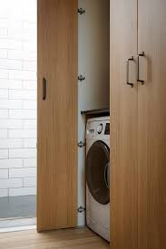 modern closet with washer and dryer