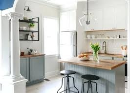 white cabinets with wood countertops lower dove grey cabinets and white uppers with natural wood for