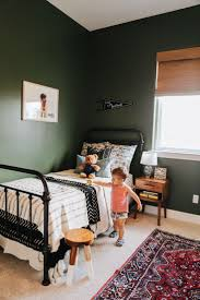 Toddler room, iron bed, dark green walls, big boy room, boy nursery, Kaila  Walls