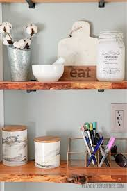 take your modern farmhouse decor to the next level with live edge wood shelves here