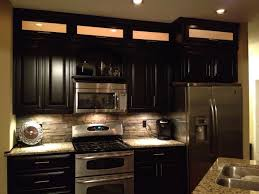 backsplash lighting. espresso cabinets light granite u0026 stacked rock backsplash with incabinet and undercabinet lighting home decor pinterest n