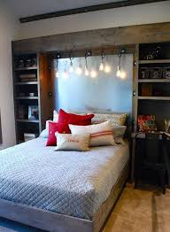 Rustic wood cabients and hanging Edison bulbs would add this awesome  industrial touch to bedroom's decor