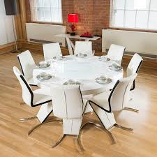 Large round white gloss dining table lazy susan, eight white/black Z Chairs.