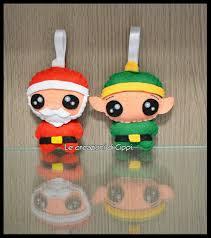 Decorazioni natalizie in pannolenci babbo natale ed elfo fatti a