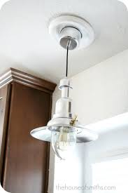 new kitchen lighting converting a can light with a recessed light adapter