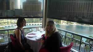 dining with eiffel tower view. sheila and me at eiffel tower restaurant dining with view