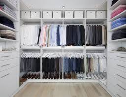 Walk in closet systems Shape All White Walk In Closet With Shelving Closet Rods Basket Storage And Cabinets The Spruce Walk In Closets Designs Ideas By California Closets