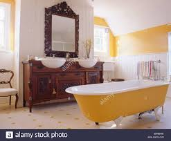 Yellow Rolltop Bath In Yellow And White Bathroom With Ornate - Yellow and white bathroom