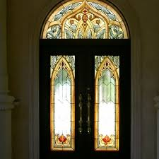 handmade stained glass entry doors and transom in a moorish style for this custom home in a gated community by art glass environments inc custommade com