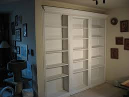 the center unit so it would open as a door this provided a library type space and provided access to the cedar closet these shelving units are of pine