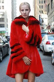 marc kaufman furs presents a red mink fur stroller with chinchilla wing collar and bell cuffs