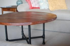 custom made custom rustic wood coffee table with industrial pipe legs
